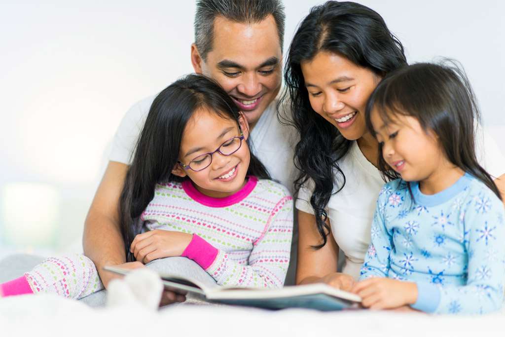 family-reading-in-bed-ages4-7